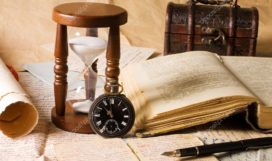 depositphotos_5269396-stock-photo-hourglass-and-the-book-vintage